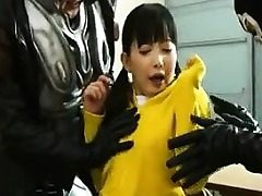 Super-cute Asian teenage is put into her super hero garment and grabs