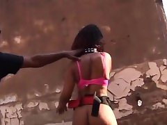African teen bound and sucks cock outdoors