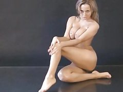 Nude bitch posing in a photograph shoot exposing her amazing figure
