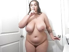 Chubby whore with giant boobs takes off her yellow dress seductively